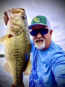 Pastor Brian Johnson shows off a fish